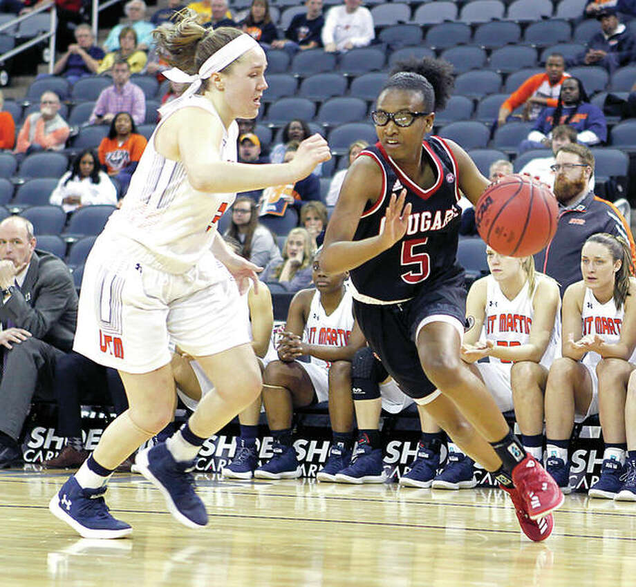 SIUE's Jay'Nee Alston (5) drives against Kendall Spray of UT Martin in Friday's Ohio Valley Conference semifinal game in Evansville, Ind. Alston scored 17 points, but SIUE lost 69-67. Photo: Michael Dann, Ohio Valley Conference