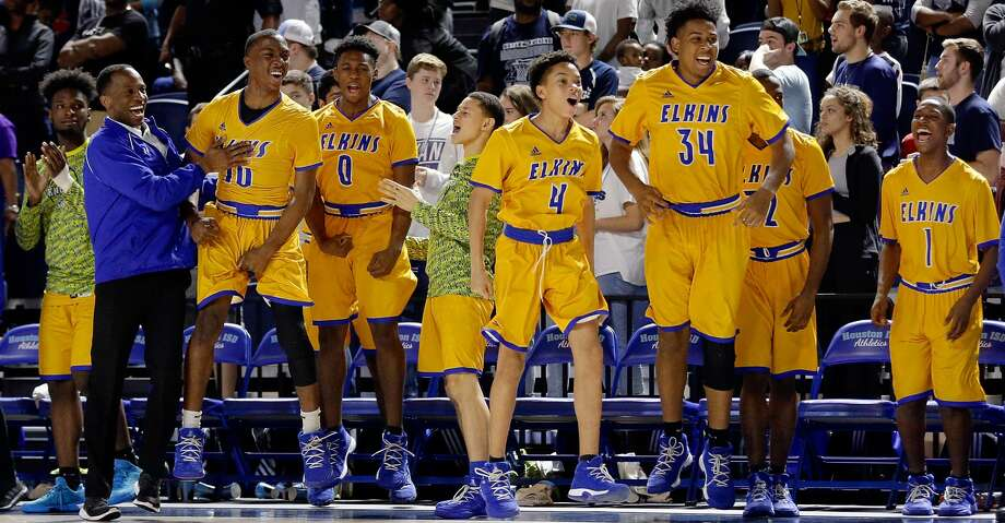 The Elkins bench celebrates their win over Bryan after the second half of their Region 3 5A semi-final game at Delmar Field House Friday, Mar. 2, 2018 in Houston, TX. (Michael Wyke / For the  Chronicle) Photo: Michael Wyke/For The Chronicle