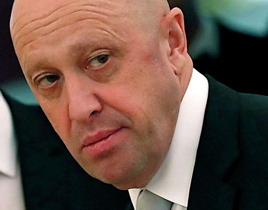 FILE - In this July 4, 2017 file photo, Russian businessman Yevgeny Prigozhin is shown prior to a meeting of Russian President Vladimir Putin and Chinese President Xi Jinping in the Kremlin in Moscow, Russia. Russian operatives working for Yevgeny Prigozhin, a Russian oligarch with ties to Russian President Vladimir Putin, used a network of fake social media accounts and targeted messaging to roil the national debate in the 2016 election, prosecutors allege.  (Sergei Ilnitsky/Pool Photo via AP) Photo: Sergei Ilnitsky / POOL EUROPEAN PRESSPHOTO AGENCY