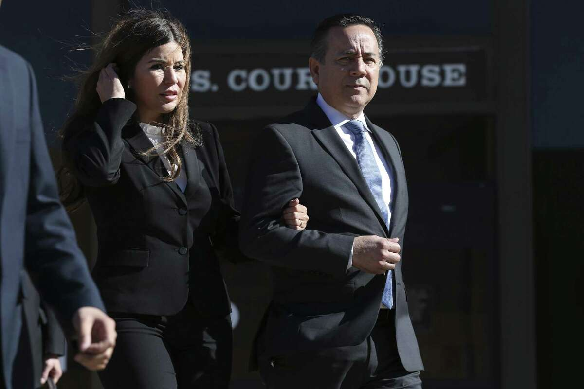 Texas State Sen. Carlos Uresti with his wife, Lleanna, leave after the first day of his criminal trial at the John H. Wood Jr. Federal Courthouse, Monday, Jan. 22, 2018. The San Antonio Democrat and co-defendant Gary Cain faced various fraud charges in connection with their roles at FourWinds Logistics, which bought and sold sand used in fracking to extract oil and gas from shale rock. A week after Uresti's conviction in the salacious trial that included vivid testimony of him carrying on an extramarital relationship, his wife has filed for divorce.