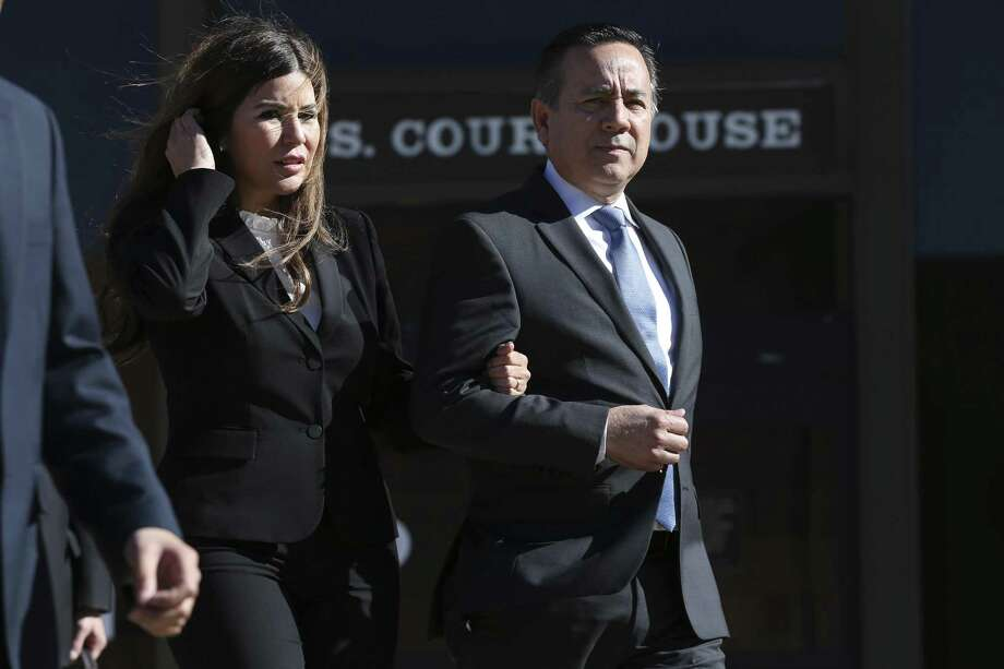 Texas State Sen. Carlos Uresti with his wife, Lleanna, leave after the first day of his criminal trial at the John H. Wood Jr. Federal Courthouse, Monday, Jan. 22, 2018. The San Antonio Democrat and co-defendant Gary Cain faced various fraud charges in connection with their roles at FourWinds Logistics, which bought and sold sand used in fracking to extract oil and gas from shale rock. A week after Uresti's conviction in the salacious trial that included vivid testimony of him carrying on an extramarital relationship, his wife has filed for divorce. Photo: JERRY LARA /San Antonio Express-News / © 2018 San Antonio Express-News
