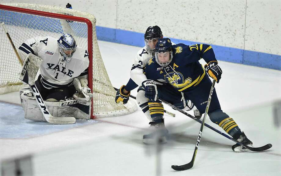 Yale's Charlie Curti and goalie Sam Tucker defend against Quinnipiac's Scott Davidson in a scoring attempt in the first game of a best-of-three first round ECAC Hockey Playoff Series. Friday, March 2, 2018, at Ingalls Rink. Photo: Catherine Avalone, Hearst Connecticut Media / New Haven Register