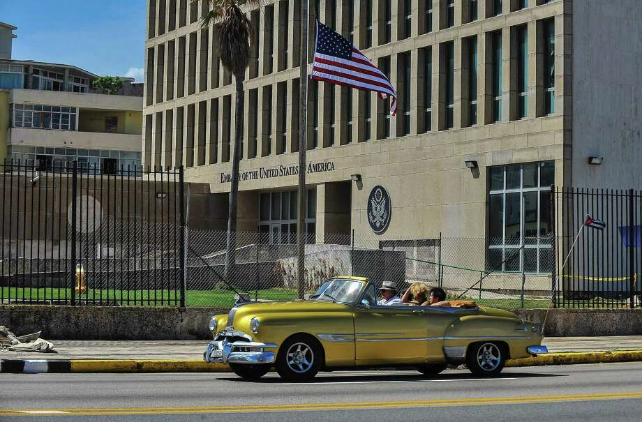"(FILES) In this file photo taken on October 3, 2017 a car drives by the US embassy in Havana,Cuba. The United States is to permanently scale back its mission to Cuba after what it alleges were series of mystery ""attacks"" on the health diplomats, the State Department said March 2, 2018. The Havana embassy had already been operating with a reduced staff since September 2017, when diplomats and family members were evacuated after suffering brain injuries.  / AFP PHOTO / YAMIL LAGEYAMIL LAGE/AFP/Getty Images Photo: YAMIL LAGE / AFP or licensors"