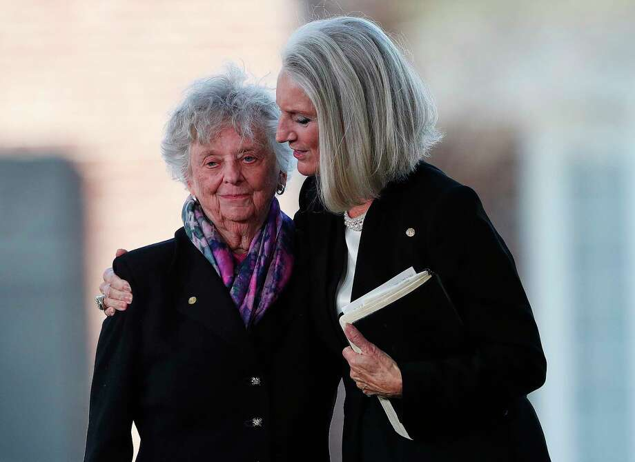 Jean Ford, left, sister of Billy Graham, and Anne Graham Lotz, daughter of the evangelist, embrace during a funeral service for Rev. Graham at the Billy Graham Library, Friday, March 2, 2018, in Charlotte, N.C. Billy Graham died last week at age 99. (AP Photo/John Bazemore) Photo: John Bazemore / Copyright 2018 The Associated Press. All rights reserved.