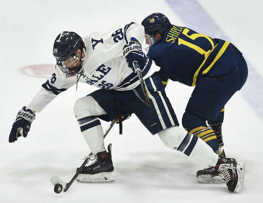 Yale's Brett Jewell advances the puck with Quinnipiac's Luke Shiplo on the chase, Friday, March 2, 2018, in the first of a best-of-three first round ECAC Hockey Playoff Series at Ingalls Rink. Photo: Catherine Avalone, Hearst Connecticut Media / New Haven Register