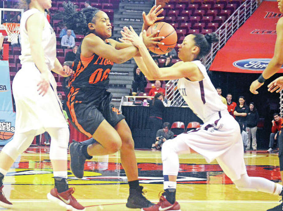 Edwardsville sophomore guard Quierra Love (06) tries to drive through the lane against Lombard Montini in Friday's IHSA Class 4A semifinal game at Redbird Arena in Normal. Photo: Matthew Kamp | For The Telegraph