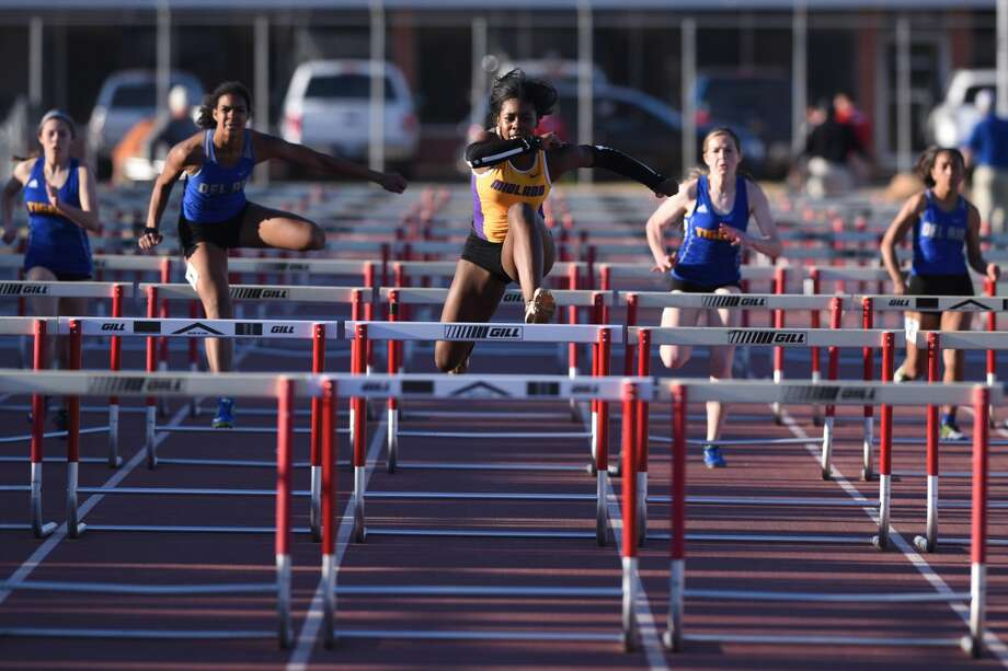 Midland High's Sametria Smith leads her competitors in the 100 meter hurdle during the Tall City Invitational track meet March 2, 2018, at Memorial Stadium. James Durbin/Reporter-Telegram Photo: James Durbin