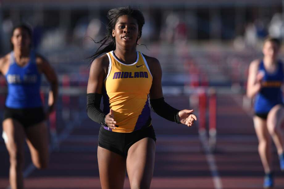 Midland High's Sametria Smith finishes first in the 100 meter hurdle during the Tall City Invitational track meet March 2, 2018, at Memorial Stadium. James Durbin/Reporter-Telegram Photo: James Durbin