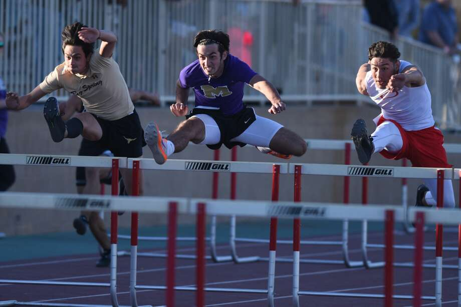 Midland High's Jacob McCracken (center) competes in the 110 meter hurdles during the Tall City Invitational track meet March 2, 2018, at Memorial Stadium. James Durbin/Reporter-Telegram Photo: James Durbin