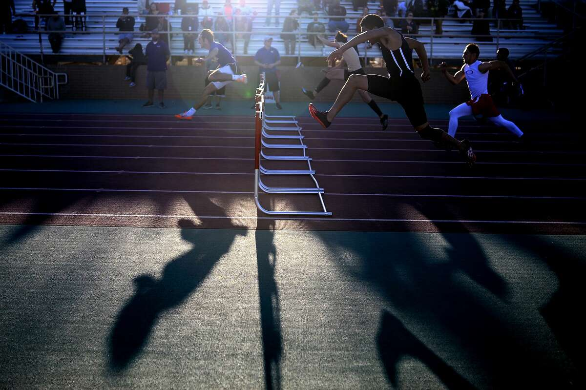 Midland High's Jacob McCracken (far left) leads his competitors in the 110 meter hurdles during the Tall City Invitational track meet March 2, 2018, at Memorial Stadium. James Durbin/Reporter-Telegram