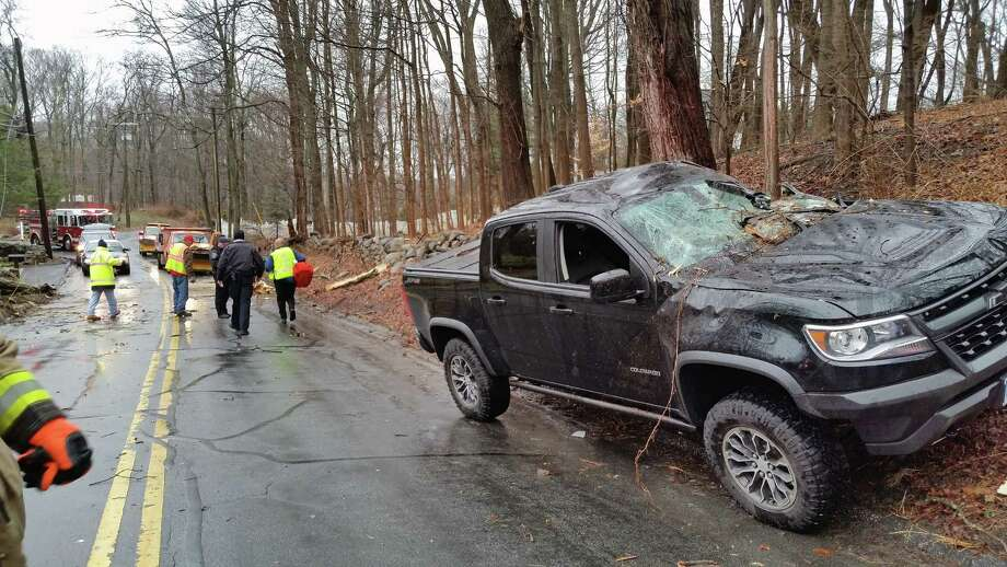 Extreme winds caused a tree to fall on a pickup truck on March 2, 2018, in New Canaan, Conn., significantly damaging a pickup truck and causing the driver to be rescued by responders. Photo: Contributed Photo / New Canaan Fire Department / Contributed Photo / Connecticut Post Contributed