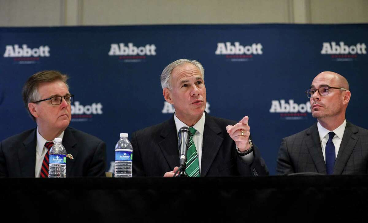 Gov. Greg Abbott, center, Lt. Gov. Dan Patrick, left, and state Rep. Dennis Bonnen, right, discuss a new property tax proposal at the Westin Galleria hotel on Jan. 16, 2018 in Houston.