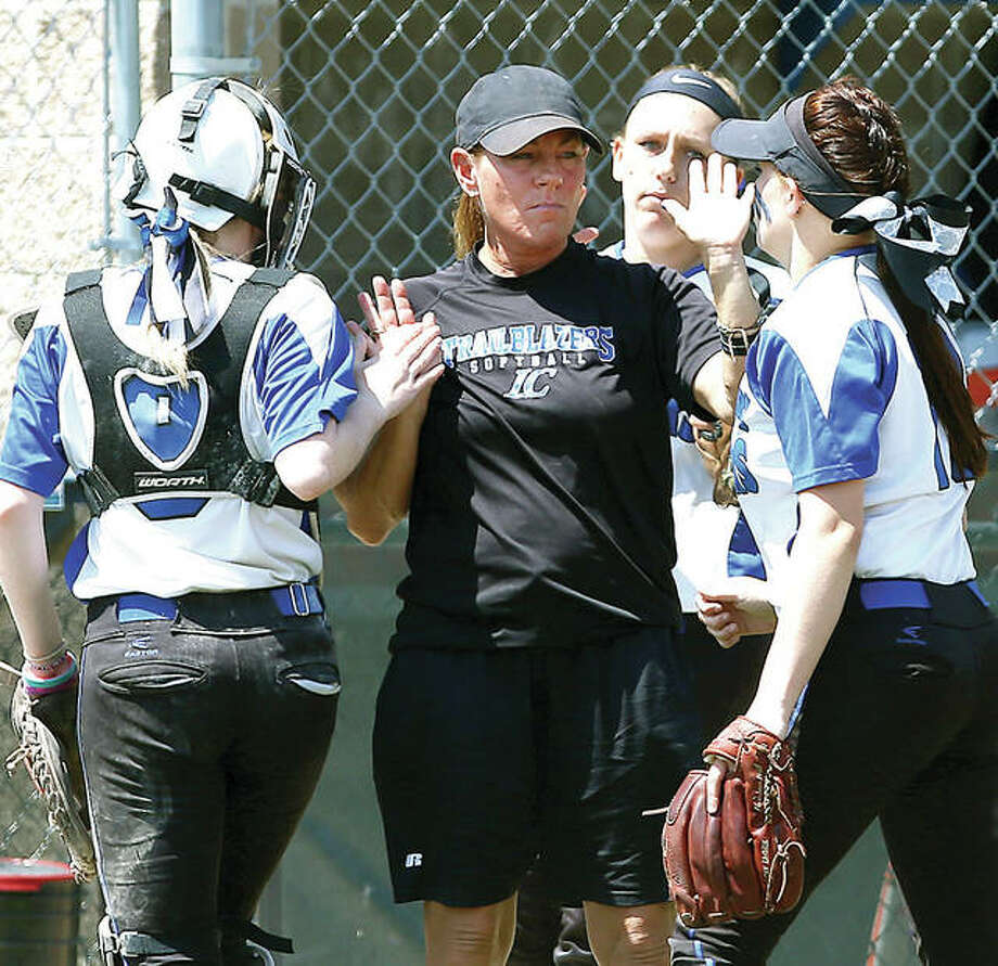 LCCC head coach Ronda Roberts, center, saw her team drop a season-opening doubleheader Friday at East Central College in Union, Mo. Roberts in shown outside the LC dugout during a game last season. Photo: LCCC Athletics