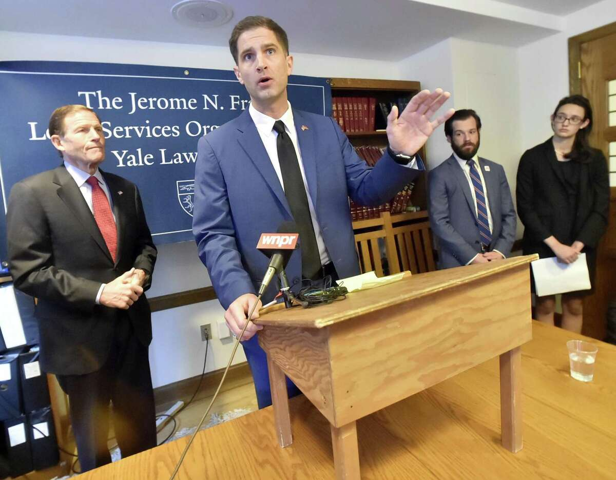 Tyson Manker, 36, of Jacksonville, Illinois, a veterans advocate and a Marine veteran, speaks during a news conference at Yale Law School Friday.