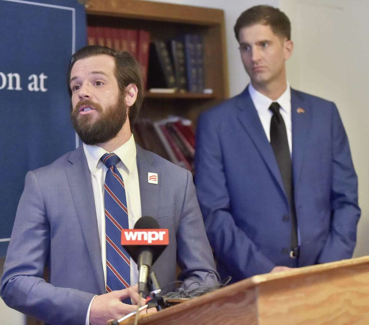 Marine veteran Tom Burke, 28, left, and attorney Tyson Manker, 36, a veterans advocate and Marine veteran, at a news conference at Yale Law School Friday.