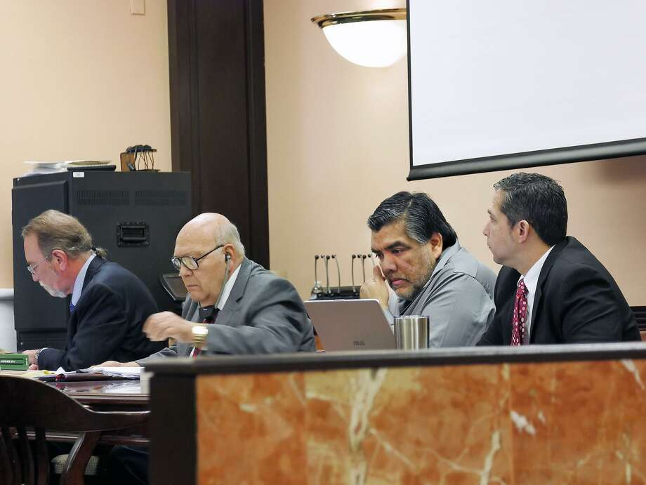 Gilberto Tello, second from left, is on trial for allegedly killing his 39-year-old wife in 2011. Photo: Cuate Santos /Laredo Morning Times / Laredo Morning Times