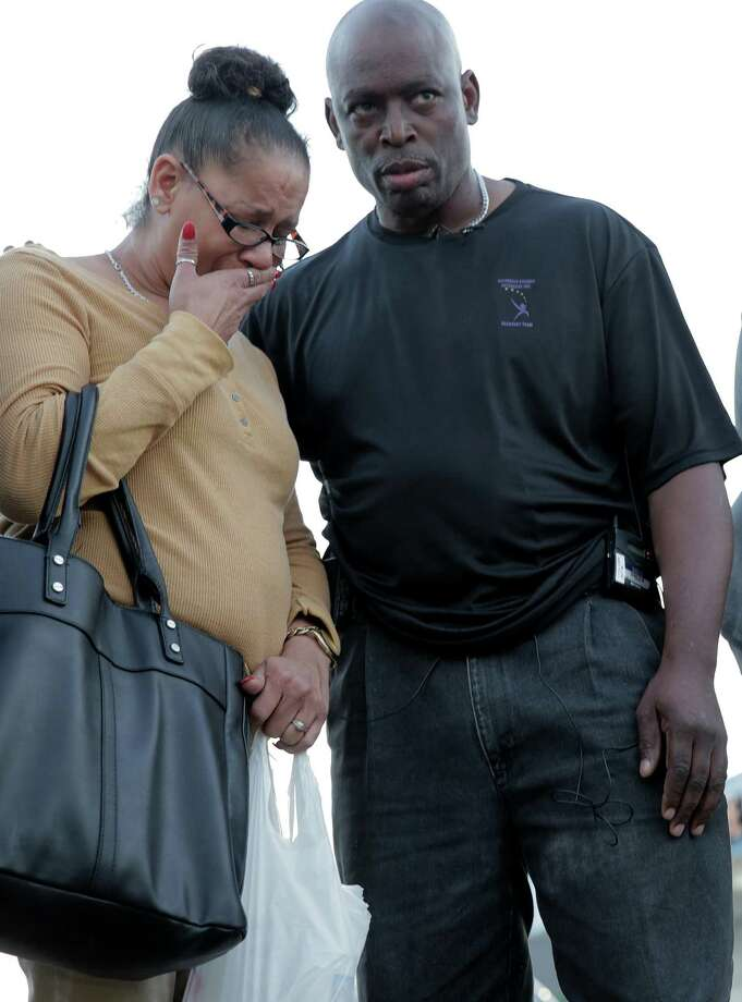 Bridgette Gaston, grandmother to two children who were shot is consoled by Reginald Gordon during a vigil on Friday, March 2, 2018, in Houston. ( Elizabeth Conley / Houston Chronicle ) Photo: Elizabeth Conley,  Chronicle / Houston Chronicle / © 2018 Houston Chronicle