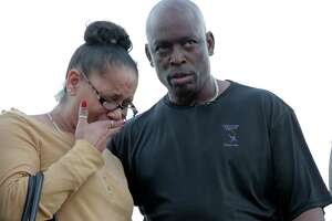 Bridgette Gaston, grandmother to two children who were shot is consoled by Reginald Gordon during a vigil on Friday, March 2, 2018, in Houston. ( Elizabeth Conley / Houston Chronicle )