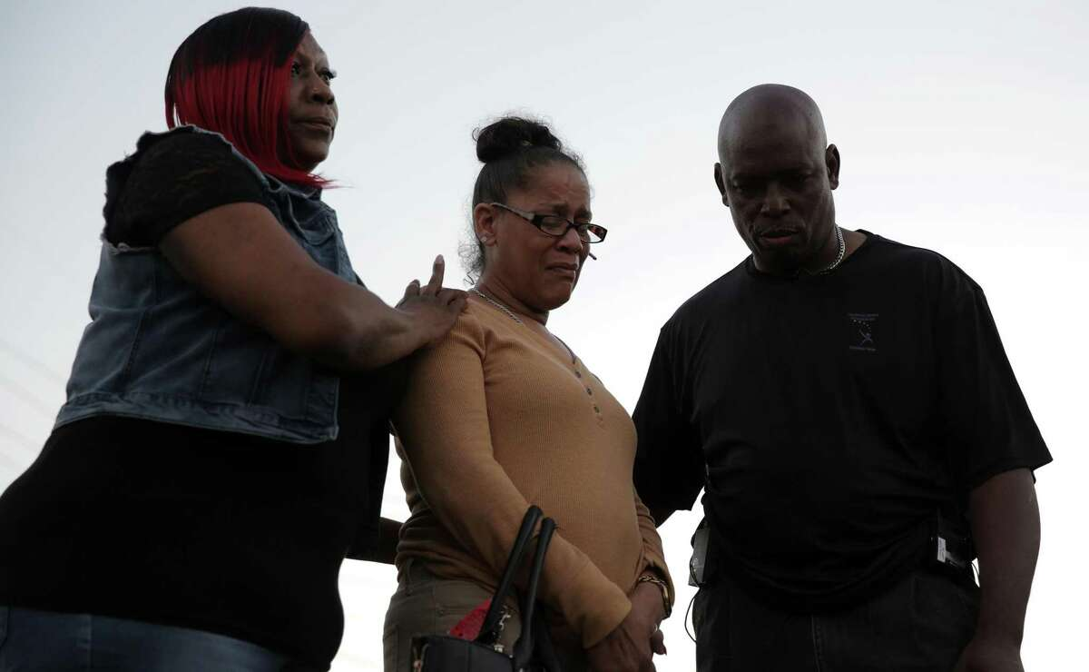 Bridgette Gaston, grandmother to two children who were shot is consoled by Reginald Gordon and Gwyn Seldon during a vigil on Friday, March 2, 2018, in Houston. ( Elizabeth Conley / Houston Chronicle )