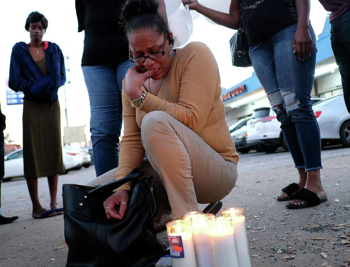 Bridgette Gaston, grandmother to two children who were shot, looks over candles she lit in the parking lot where the incident happened on Friday, March 2, 2018, in Houston. ( Elizabeth Conley / Houston Chronicle )