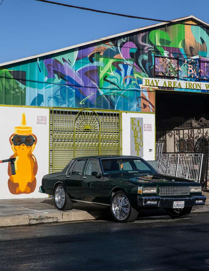 Colorful murals adorn storefronts in the Bayview. Photo: Jessica Christian, The Chronicle