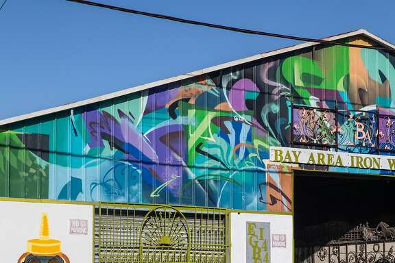 Colorful murals are seen painted on multiple storefronts Thursday, March 1, 2018 in the Bayview District of San Francisco, Calif.