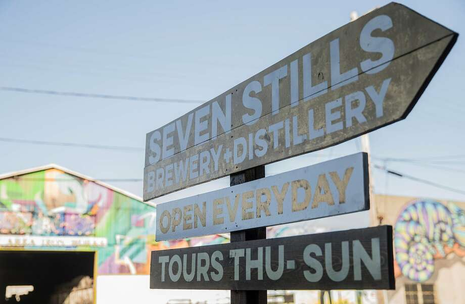 A sign points to the entrance of Seven Stills Brewery & Distillery in the Bayview. Photo: Jessica Christian, The Chronicle