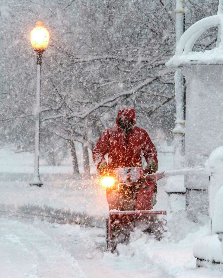 A snowblower operator cuts in to the heavy snow in Congress Park during a nor'easter snow storm that hit the area on Friday, March, 2 2018, Saratoga Springs, N.Y.   (Skip Dickstein/Times Union) Photo: SKIP DICKSTEIN