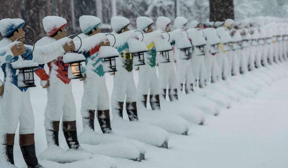 Lawn jockeys line up on the front lawn of the National Museum of Racing and Hall of Fame in the heavy snow during a nor'easter snow storm that hit the area on Friday, March, 2 2018, Saratoga Springs, N.Y.   (Skip Dickstein/Times Union) Photo: SKIP DICKSTEIN