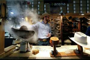 Clay Hand, of Sombrero Brands, steams a hat as he shapes it in their booth during the Houston Livestock Show and Rodeo at NRG Arena, Friday, March 2, 2018, in Houston.