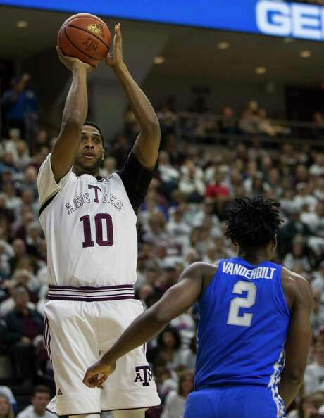 A&M forward Tonny Trocha-Morelos (10) shoots over forward Jarred Vanderbilt in the win over Kentucky. Photo: Sam Craft, FRE / AP