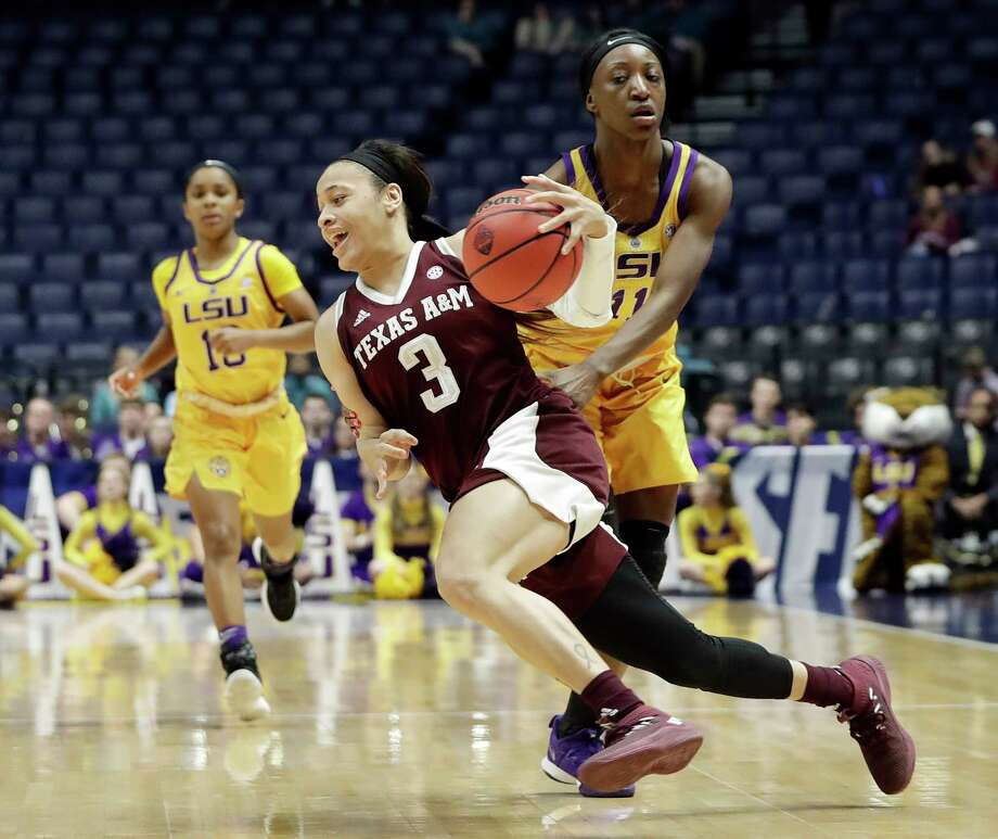 Texas A&M's Chennedy Carter (3) cuts around LSU's Raigyne Louis (11) in the second half of Friday's game at Nashville, Tenn. Photo: Mark Humphrey, STF / Copyright 2018 The Associated Press. All rights reserved.