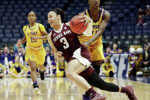 Texas A&M's Chennedy Carter (3) cuts around LSU's Raigyne Louis (11) in the second half of Friday's game at Nashville, Tenn.