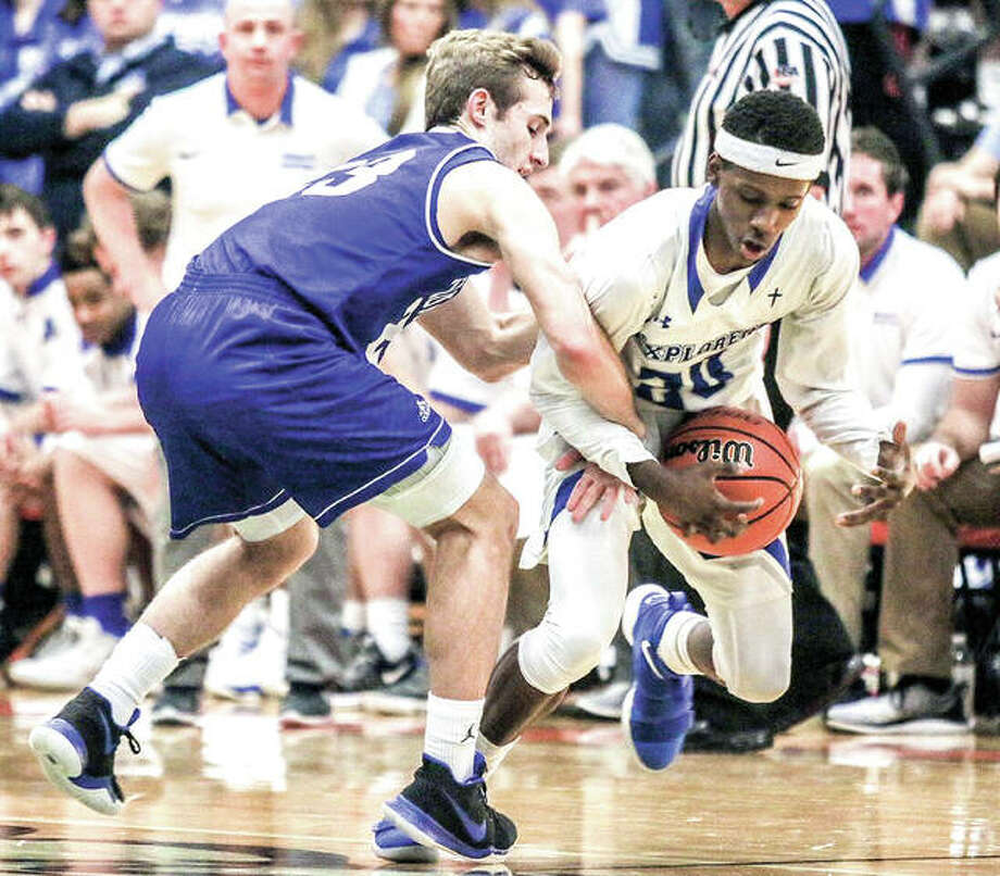 Marquette's Isaiah Ervin, right, strips the ball from Columbia's Jordan Holmes during Friday night's Waterloo Class 3A Regional championship game. Photo: Nathan Woodside   For The Telegraph