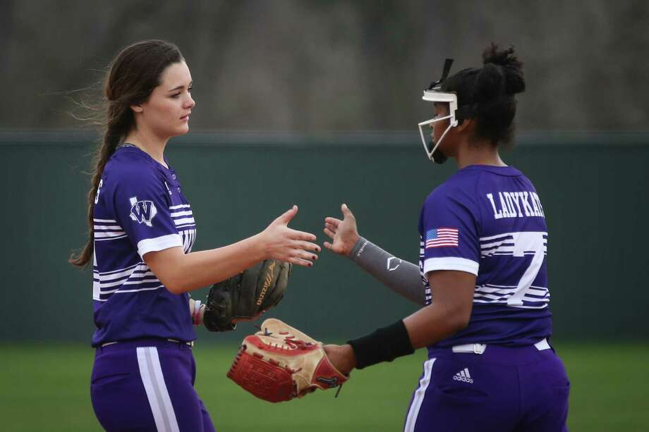 Willis' McKenzie Parker (9) and Samra Lagway (7) slap hands after Lagway struck out a Spring player during the softball game on Saturday, Feb. 24, 2018, at Willis High School. (Michael Minasi / Houston Chronicle) Photo: Michael Minasi, Staff Photographer / © 2017 Houston Chronicle