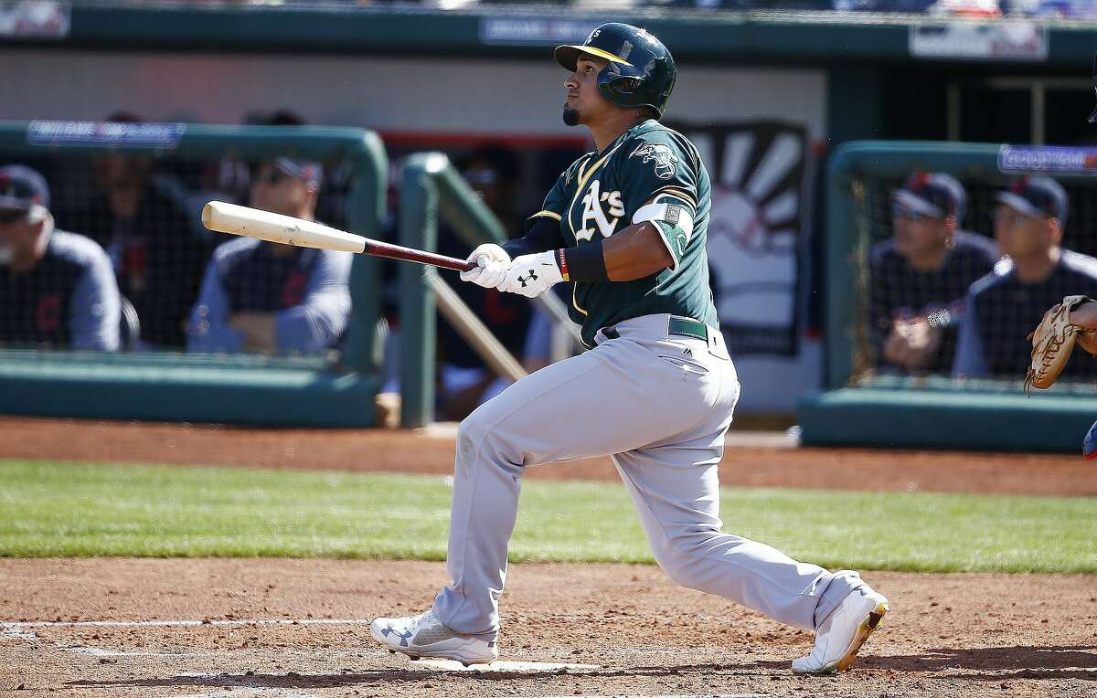 Oakland Athletics' Franklin Barreto watches the flight of his triple against the Cleveland Indians during the third inning of a spring training baseball game Tuesday, Feb. 27, 2018, in Goodyear, Ariz. The Indians defeated the Athletics 16-8. (AP Photo/Ross D. Franklin)