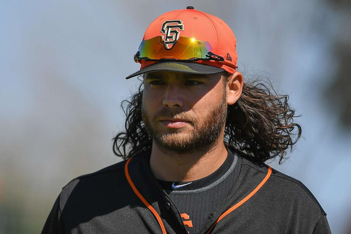 SCOTTSDALE, AZ - FEBRUARY 26: Brandon Crawford #35 of the San Francisco Giants warms up prior to the spring training game against the Kansas City Royals at Scottsdale Stadium on February 26, 2018 in Scottsdale, Arizona. ~~