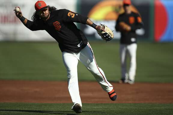 San Francisco Giants' Brandon Crawford throws during practice prior to a spring training baseball game against the Arizona Diamondbacks on Tuesday, Feb. 27, 2018, in Scottsdale, Ariz. (AP Photo/Ben Margot)