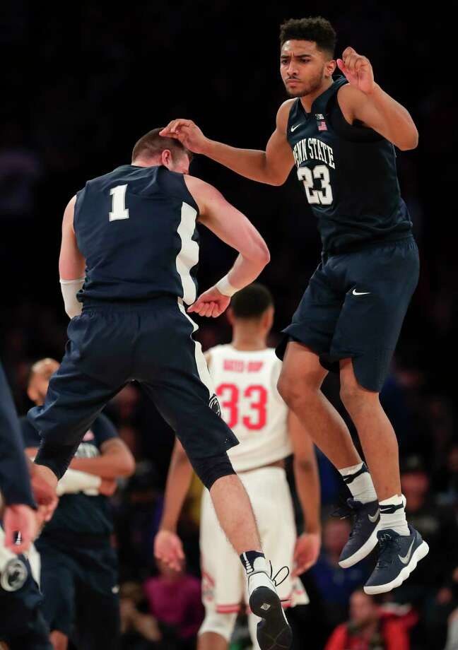 Penn State guard Josh Reaves (23) celebrates with forward Deividas Zemgulis (1) after Penn State beat Ohio State 69-68 in an NCAA Big Ten Conference tournament college basketball game, Friday, March 2, 2018, in New York. (AP Photo/Julie Jacobson) Photo: Julie Jacobson / Copyright 2018 The Associated Press. All rights reserved.
