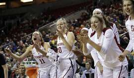 Stanford players cheer from the bench after a score against Southern California during the second half of an NCAA college basketball game in the quarterfinals of the Pac-12 women's tournament Friday, March 2, 2018, in Seattle. (AP Photo/Elaine Thompson)