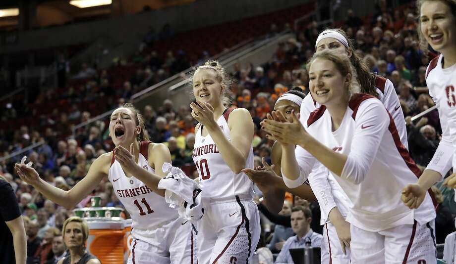 Stanford players cheer from the bench during the Cardinal's Pac-12 tournament win over USC Friday in Seattle. Photo: Elaine Thompson, Associated Press