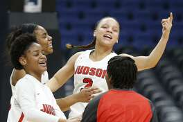 JudsonÕs Kierra Sanderlin (from left), Desiree Lewis, Corina Carter, and Demiya Barnett celebrate their 71-66 win over Sachse after the UIL Class 6A girls state semifinal game held Friday March 2, 2018 at the Alamodome.
