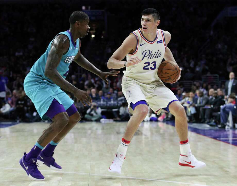 Philadelphia 76ers' Ersan Ilyasova, right, of Turkey, looks to make his move on Charlotte Hornets' Marvin Williams, left, during the second half of an NBA basketball game Friday, March 2, 2018, in Philadelphia. The 76ers won 110-99. (AP Photo/Chris Szagola) Photo: Chris Szagola / FR170982 AP