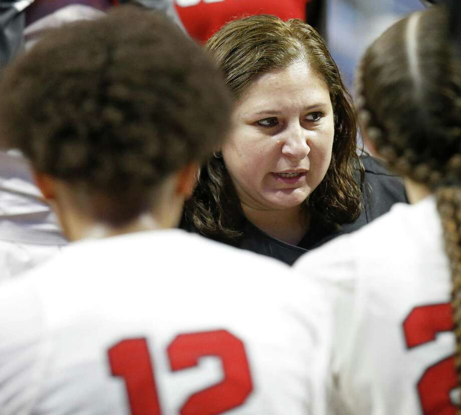 Judson head coach Triva Corrales talks with the team during a timeout in their UIL Class 6A girls state semifinal game against Sachse, Friday March 2, 2018 at the Alamodome. Judson won 71-66. Photo: Edward A. Ornelas, Staff / San Antonio Express-News / © 2018 San Antonio Express-News
