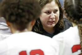 Judson head coach Triva Corrales talks with the team during a timeout in their UIL Class 6A girls state semifinal game against Sachse, Friday March 2, 2018 at the Alamodome. Judson won 71-66.