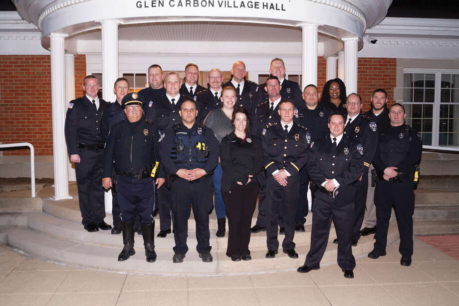 Members of the Glen Carbon Police Department stand with retiring Sgt. Paul Cates, fifth from left in back (wearing glasses), outside Village Hall. Photo: For The Intelligencer