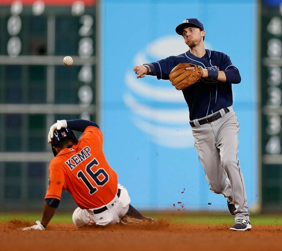 Tampa Bay Rays shortstop Matt Duffy (5) makes the throw to first after tagging Houston Astros Tony Kemp (16) out as Marwin Gonzalez grounded into a double play in the seventh inning of an MLB game at Minute Maid Park, Friday, Aug. 26, 2016 in Houston. ( Karen Warren / Houston Chronicle ) Photo: Karen Warren, Houston Chronicle