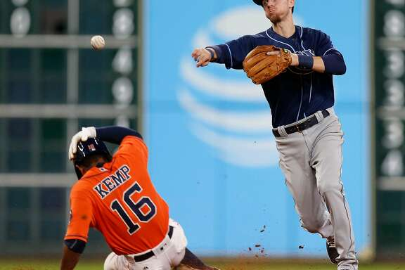 Tampa Bay Rays shortstop Matt Duffy (5) makes the throw to first after tagging Houston Astros Tony Kemp (16) out as Marwin Gonzalez grounded into a double play in the seventh inning of an MLB game at Minute Maid Park, Friday, Aug. 26, 2016 in Houston. ( Karen Warren / Houston Chronicle )