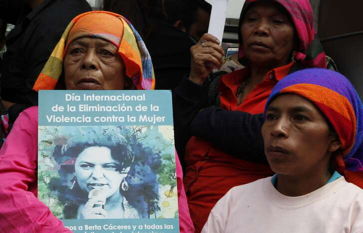Family, friends and activists gather outside the Prosecutor's Office to demand justice for the murder of environmental activist and Goldman Environmental Prize winner Berta Caceres, in Tegucigalpa, Honduras, Friday, March 2, 2018. The authorities� failure to identify those who ordered the brutal murder of Caceres and bring them to justice puts hundreds of human rights defenders at grave risk, said Amnesty International on the second anniversary of her killing. (AP Photo/Fernando Antonio)