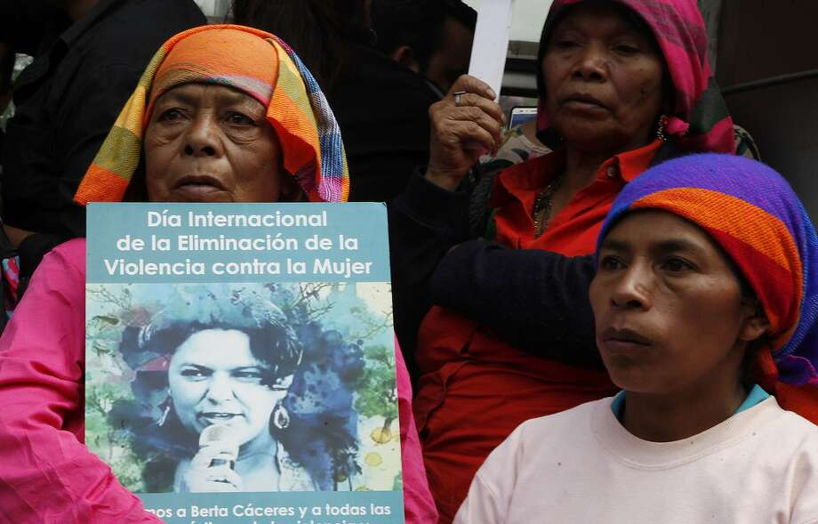 Demonstrators gather Friday in Tegucigalpa, Honduras, to demand justice in the slaying of activist Berta Caceres. Photo: Fernando Antonio, Associated Press